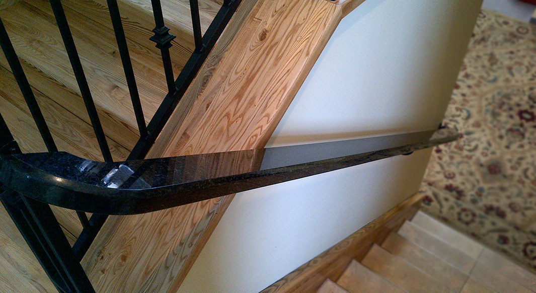 Black Pearl Custom Handrail - Bevel Edge Profile Atop Iron Banister